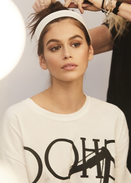 Kaia Gerber wearing limited edition apparel behind the scenes of Jimmy Choo Spring Summer 2019