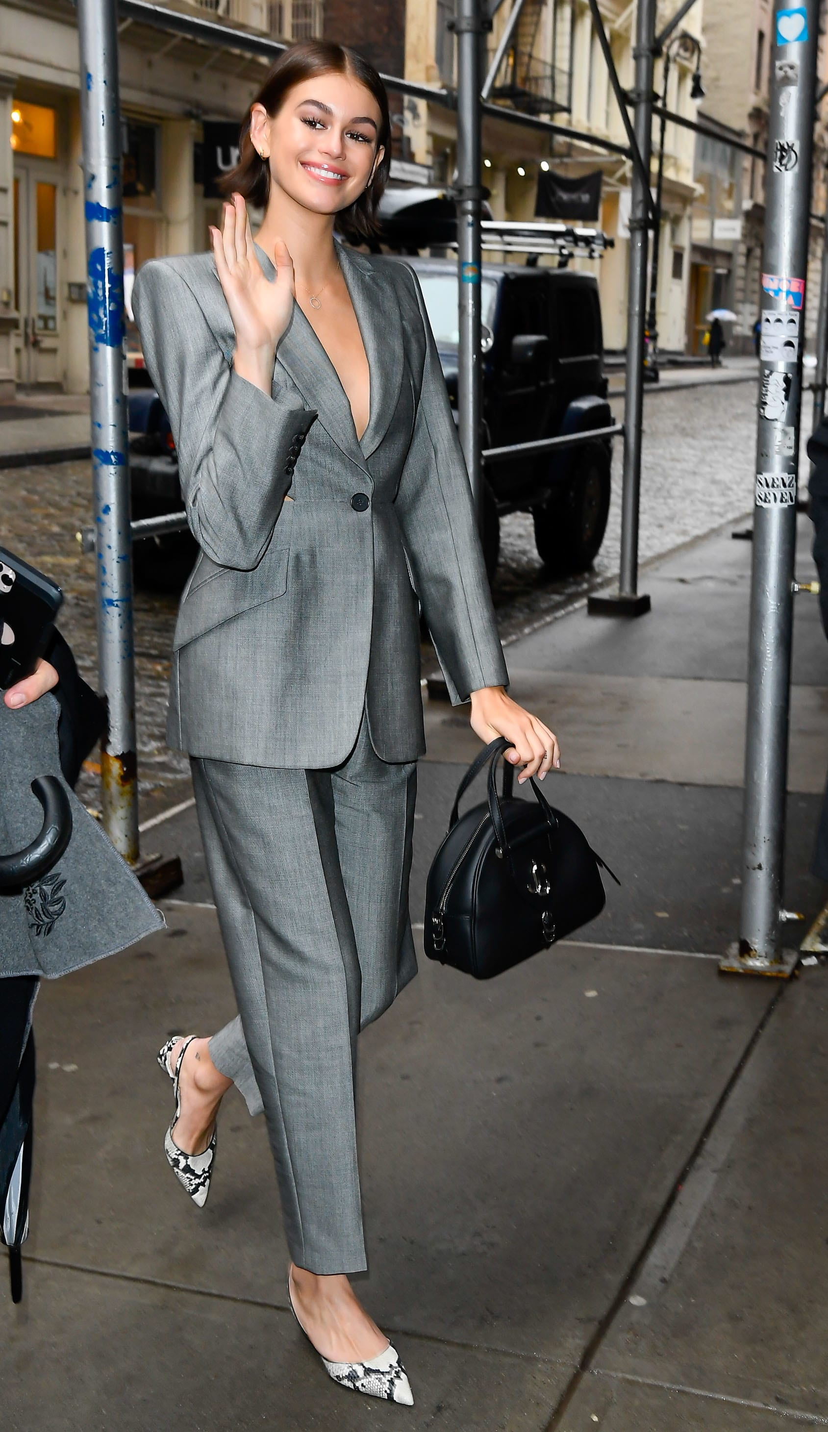 Kaia Gerber wearing K-SLINGBACK and carrying VARENNE BOWLING