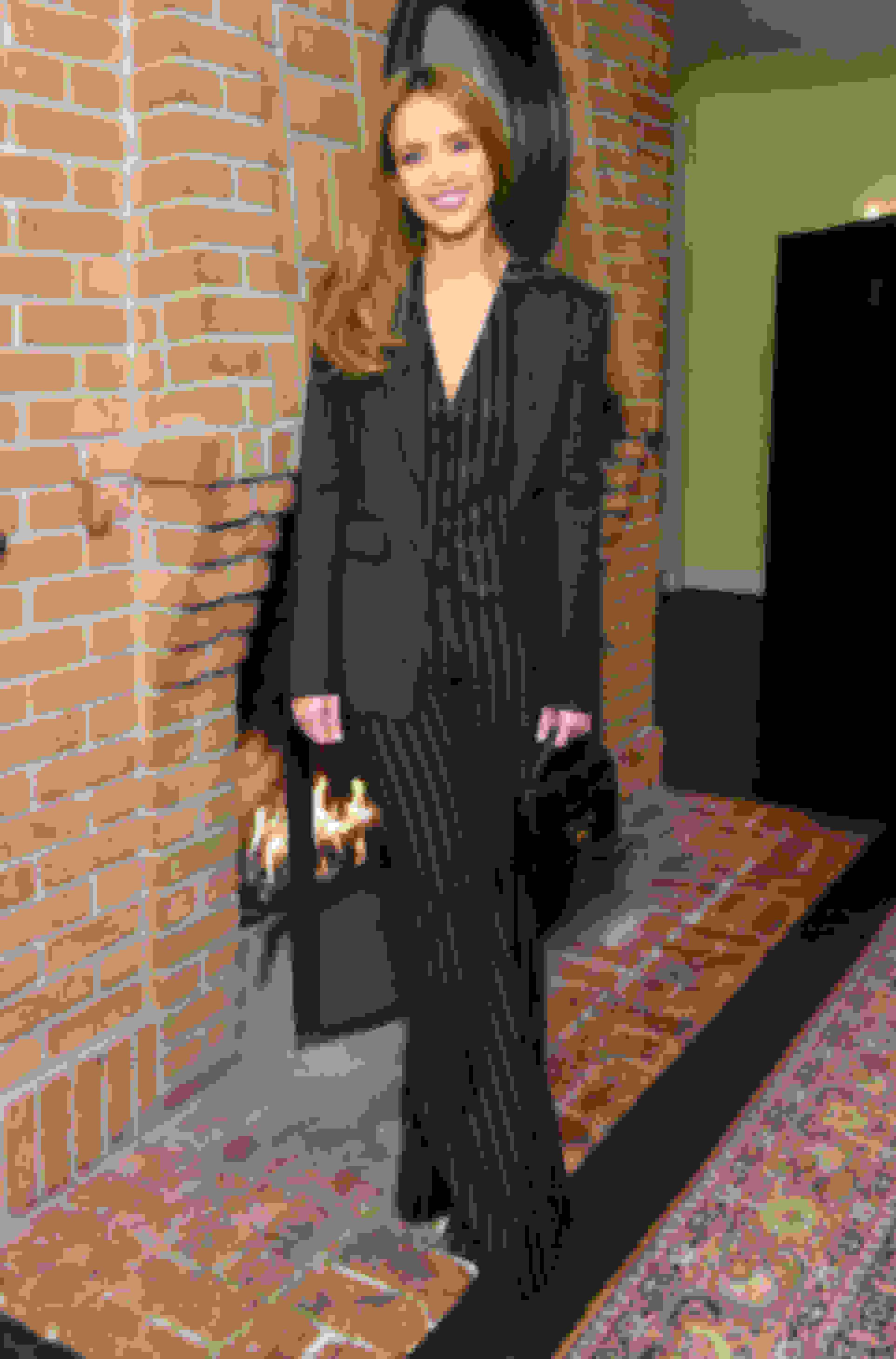 Jessica Alba carrying REBEL