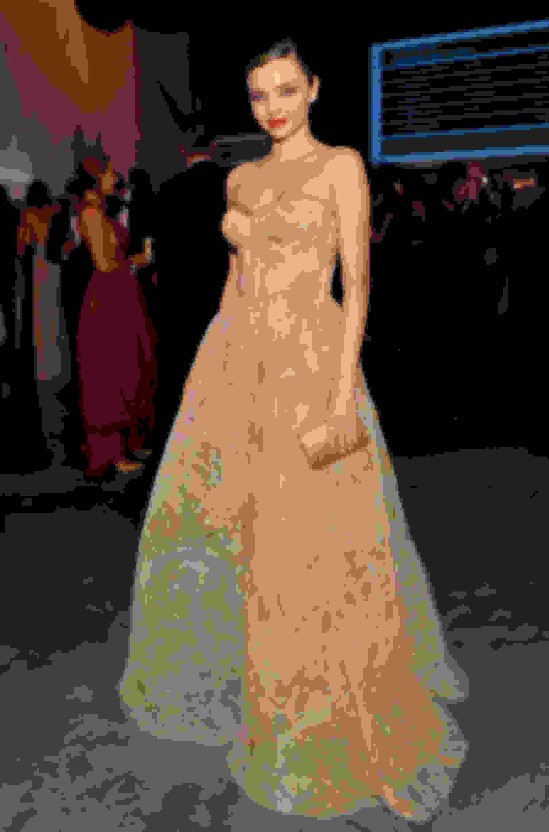 Miranda Kerr carrying CARMEN