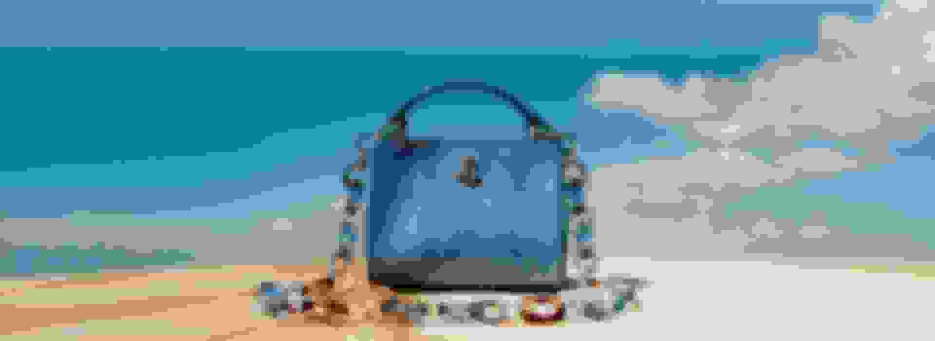 Jimmy Choo women's mini handbag in blue shade with tortoiseshell plexi chain