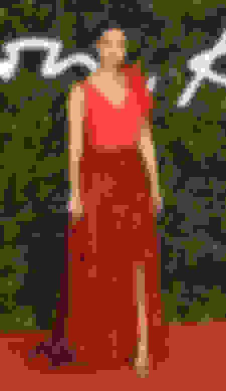 Nathalie Emmanuel wearing KAYLEE and carrying VIVIEN