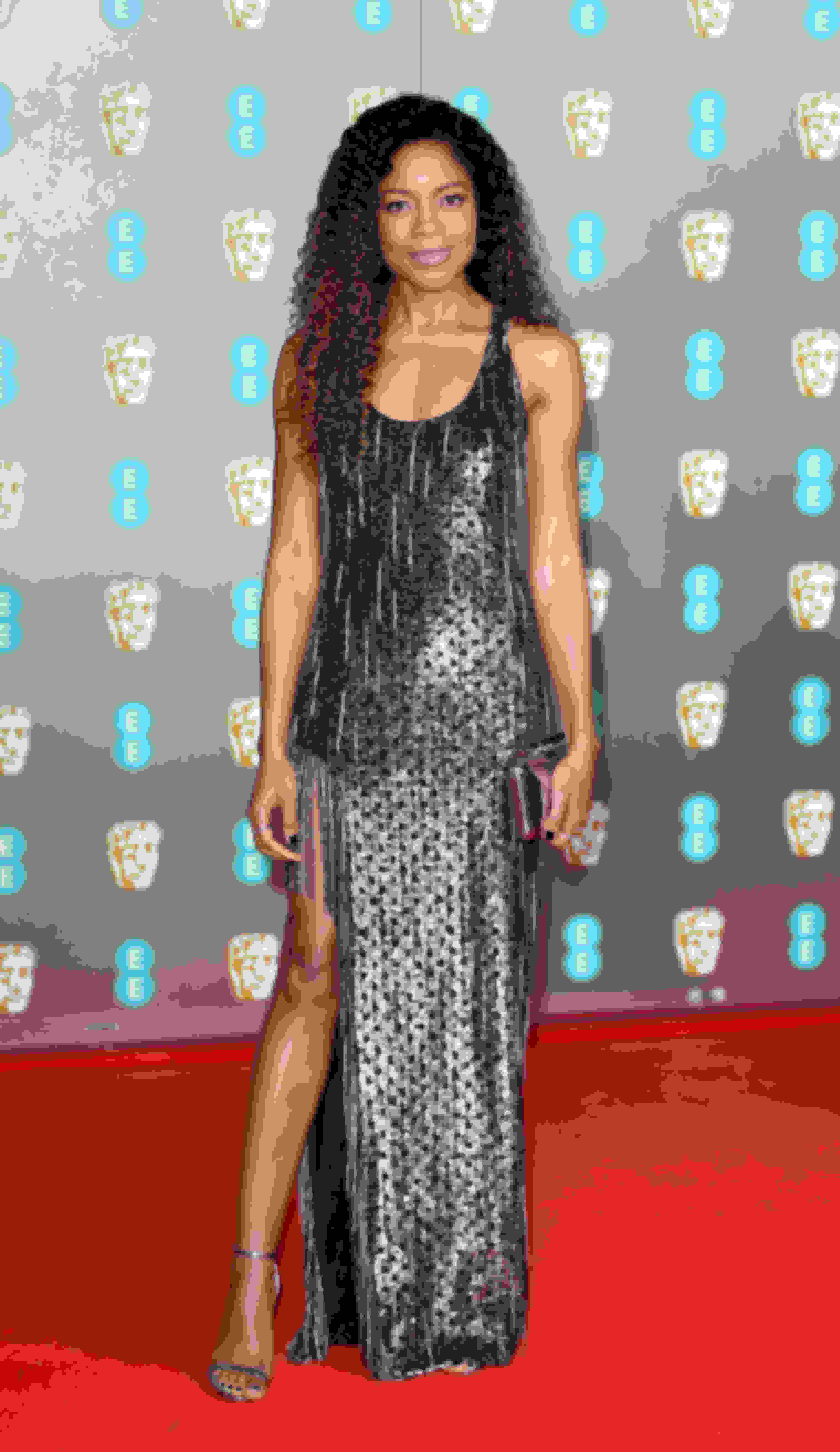 Naomie Harris wearing MINNY and carrying ELLIPSE