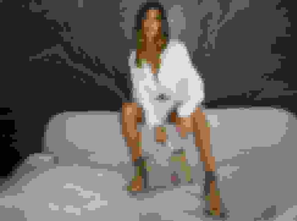 Hailey Bieber wearing Jimmy Choo women's caramel chunky boots and holding caramel monogrammed leather handbag