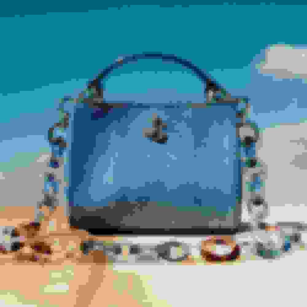 Jimmy Choo women's mini handbag in blue hue with tortoiseshell plexi chain