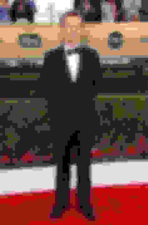 Alfie Allen wearing John