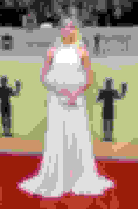 Margot Robbie carrying CELESTE