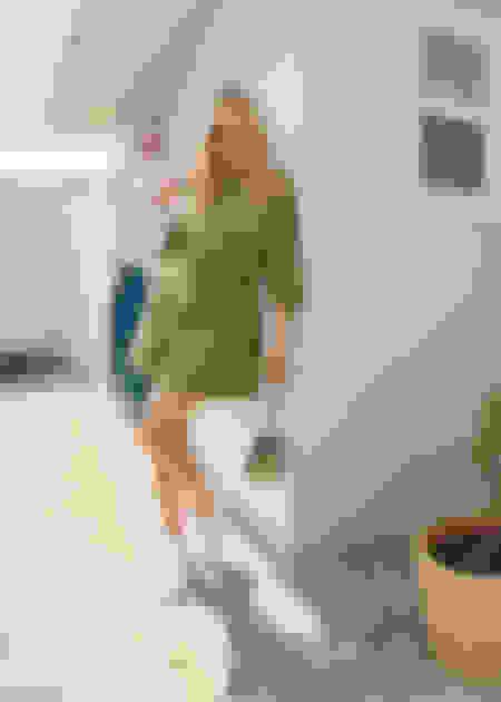 Chloe Sevigny wearing MIAMI sneakers and LOCKETT PETITE shoulder bag